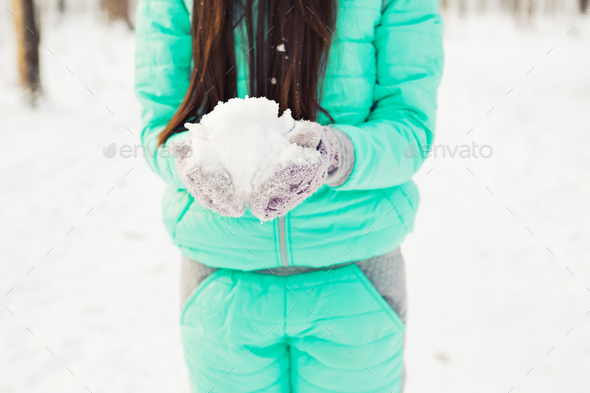 Young woman with snow - Stock Photo - Images