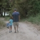 Child Walking Through The Wood With Grandpa - VideoHive Item for Sale