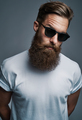 Bearded man in sunglasses with raised eyebrow