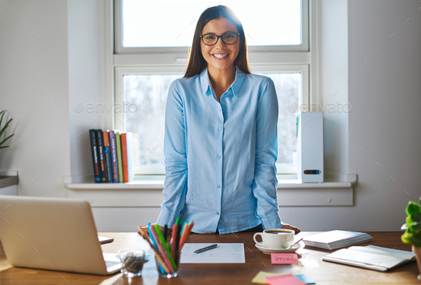 Happy female entrepreneur with a confident smile - Stock Photo - Images