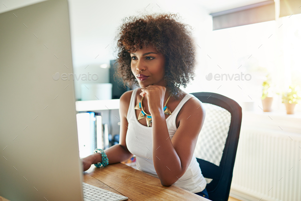 Pretty young female entrepreneur - Stock Photo - Images