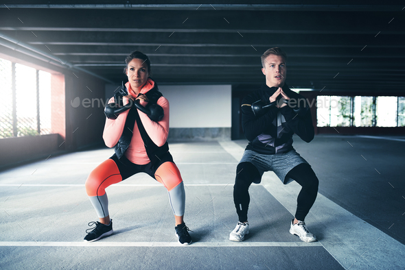 Man and woman exercising with weights - Stock Photo - Images