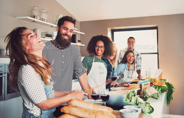 Group of foodies preparing a meal together - Stock Photo - Images