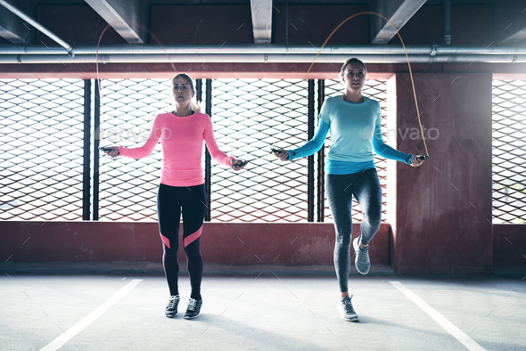 Sporty women doing jumping rope - Stock Photo - Images