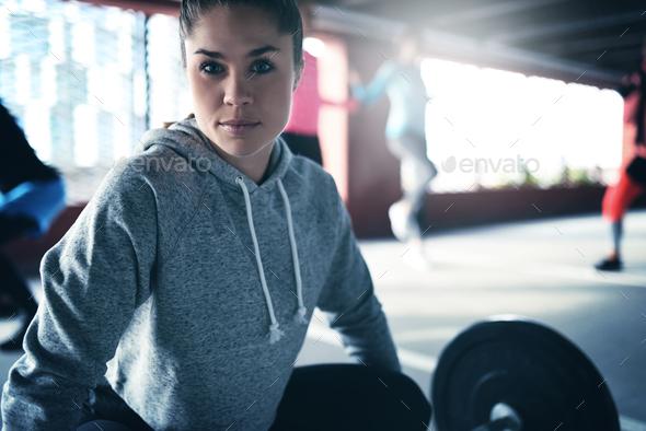 Beautiful sportswoman looking at camera. - Stock Photo - Images