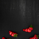 Sliced strawberries with leaves on black backfround. Top view, frame. Copy space. Summer fruit - PhotoDune Item for Sale
