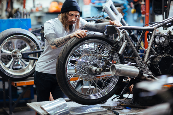 Repairing motorcycle - Stock Photo - Images
