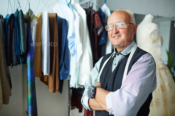 Confident tailor with crossed arms - Stock Photo - Images