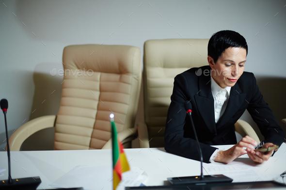 Female delegate on break - Stock Photo - Images