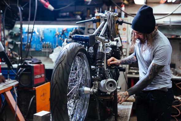 Repairman in garage - Stock Photo - Images