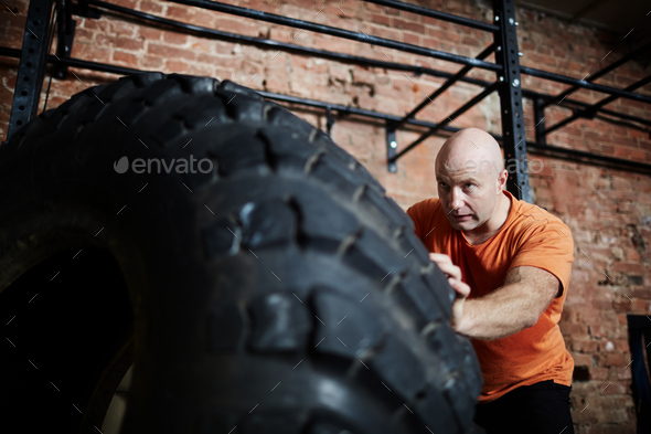 Workout with tire - Stock Photo - Images