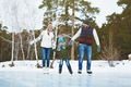 Cheerful family skating in park - PhotoDune Item for Sale