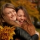 Beautiful Teenage Girls Having Fun In Autumn Park . Two Young Laughing Girls Hugging In The Autumn - VideoHive Item for Sale