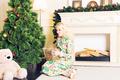 woman sitting on floor near christmas tree  - PhotoDune Item for Sale