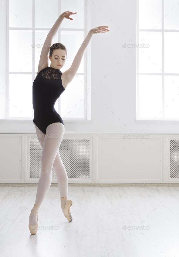 Beautiful ballerine stands in ballet position