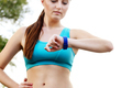 Woman using fitness bracelet - PhotoDune Item for Sale