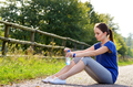 Woman resting after jogging - PhotoDune Item for Sale