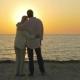 Loving Senior Couple Enjoying Sunset Over Sea - VideoHive Item for Sale