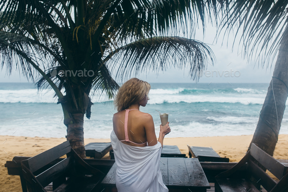 girl on a bench drink cocktails - Stock Photo - Images