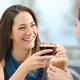 Two women friends talking in a coffee shop - PhotoDune Item for Sale