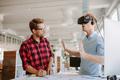 Young men testing virtual reality headset