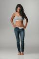 Calm woman in unzipped blue jeans
