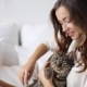 Happy Young Woman With Cat In Bed At Home 9 - VideoHive Item for Sale