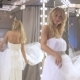 Lovely Bride Dancing Near Mirror In Wedding Dress