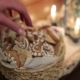 Woman's Hand Take Christmas Cookies From Basket - VideoHive Item for Sale