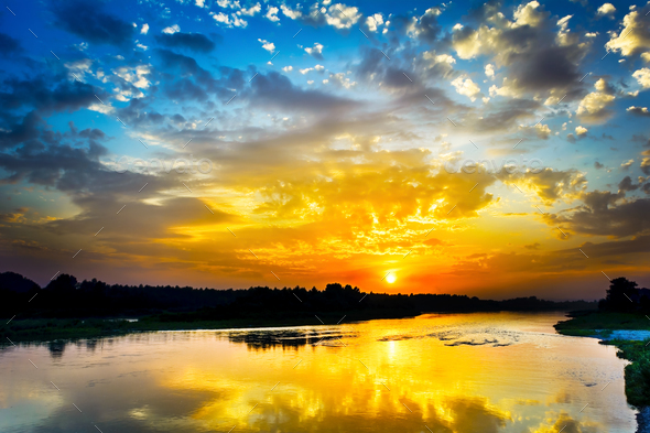 Beautiful lake landscape with vivid sunrise on the cloudy sky - Stock Photo - Images