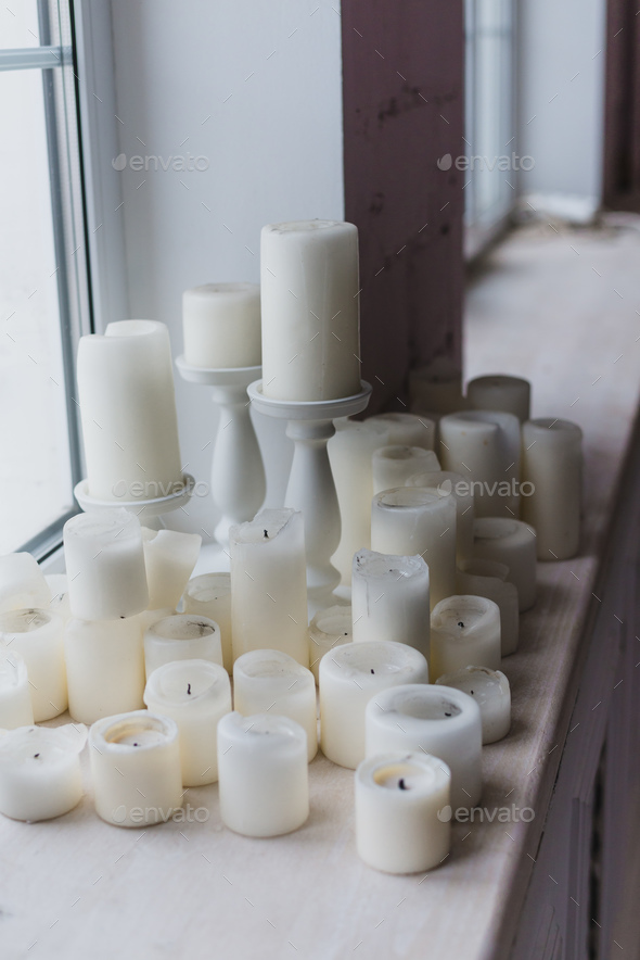 Candles near the window christmas decoration - Stock Photo - Images