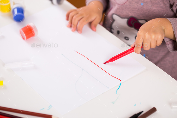 little girl drawing with colored pencils on paper - Stock Photo - Images