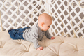 Adorable baby boy in white sunny bedroom - PhotoDune Item for Sale