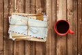 Pile of old envelopes and coffee cup on wooden table top view - PhotoDune Item for Sale