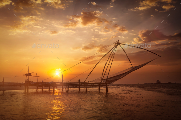 Chinese fishnets on sunset. Kochi, Kerala, India - Stock Photo - Images