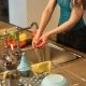 Young Woman Washing Vegetables - VideoHive Item for Sale