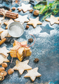 Christmas star shaped cookies with spices and fir-tree branch