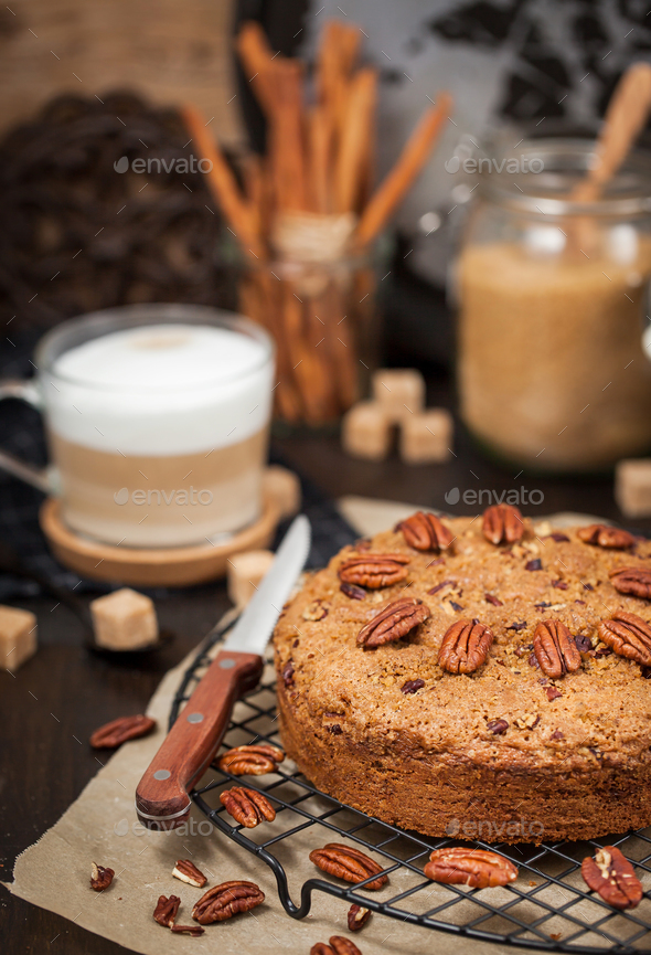 Delicious fresh homemade cinnamon and pecan coffee cake - Stock Photo - Images