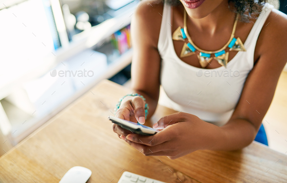 Woman with cell indoors. - Stock Photo - Images