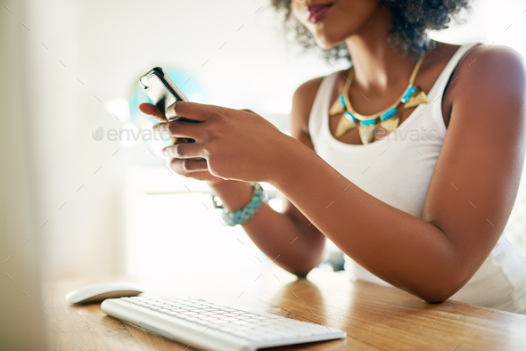 Crop shot of woman using smartphone - Stock Photo - Images