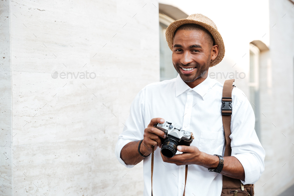 Portrait of an African male photographer - Stock Photo - Images