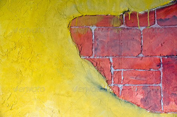 Yellow plaster and a red brickwall - Stock Photo - Images