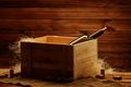 Bottle of wine in box in wooden interior