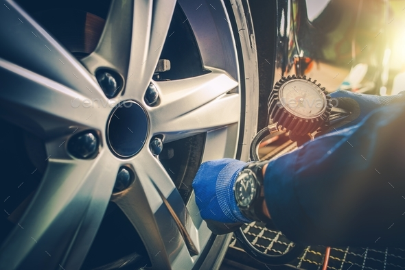 Car Tire Pressure Check - Stock Photo - Images