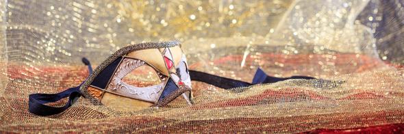 Carnival mask on golden blur background - Stock Photo - Images