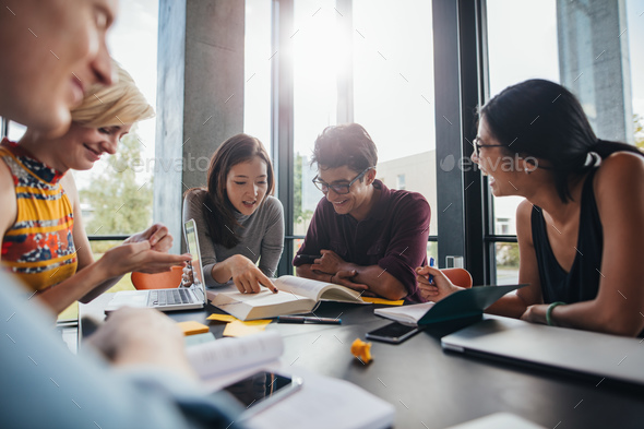 University students doing group study in library - Stock Photo - Images