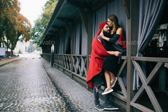 couple posing on a city street - Stock Photo - Images