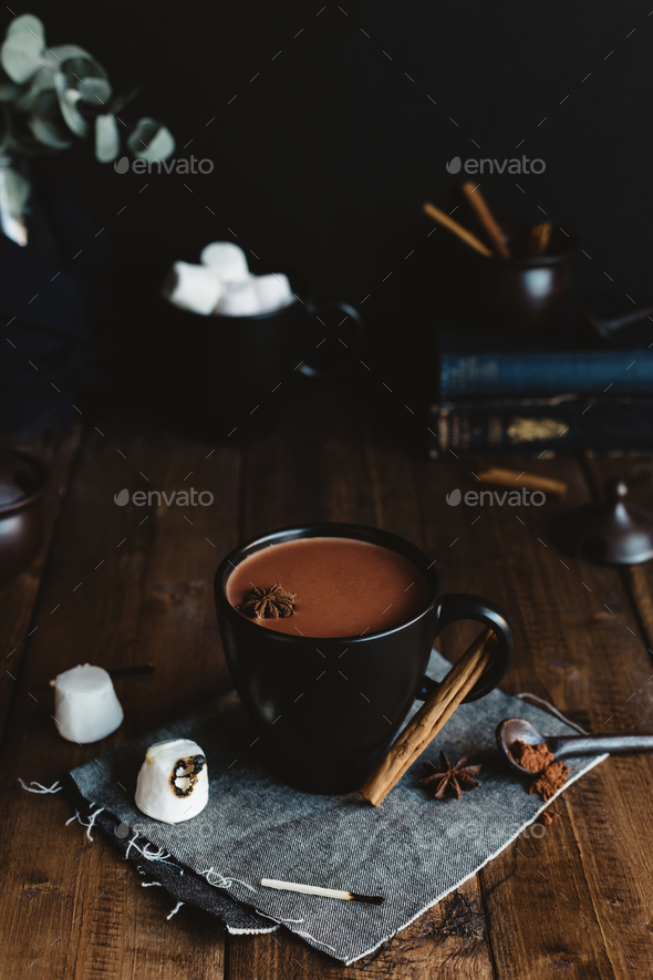 Mug of Hot Cocoa with Marshmallows and Cinnamon Sticks on Rustic Table - Stock Photo - Images