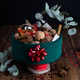 Horizontal View of Christmas Tin filled with Nuts and Spices on Rustic Table - PhotoDune Item for Sale