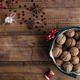 Walnuts in Christmas Tin with Festive Decorations on Rustic Table - PhotoDune Item for Sale